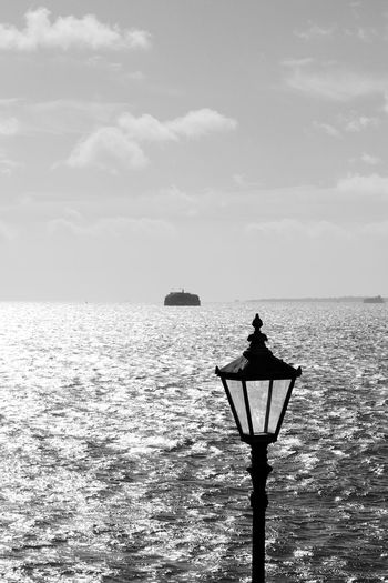 Lamp Lighting The Sea Black & White Blackandwhite Day Horizon Over Water Lighting Equipment Nature No People Outdoors Scenics Sea Sky Street Light Tranquil Scene Tranquility Water