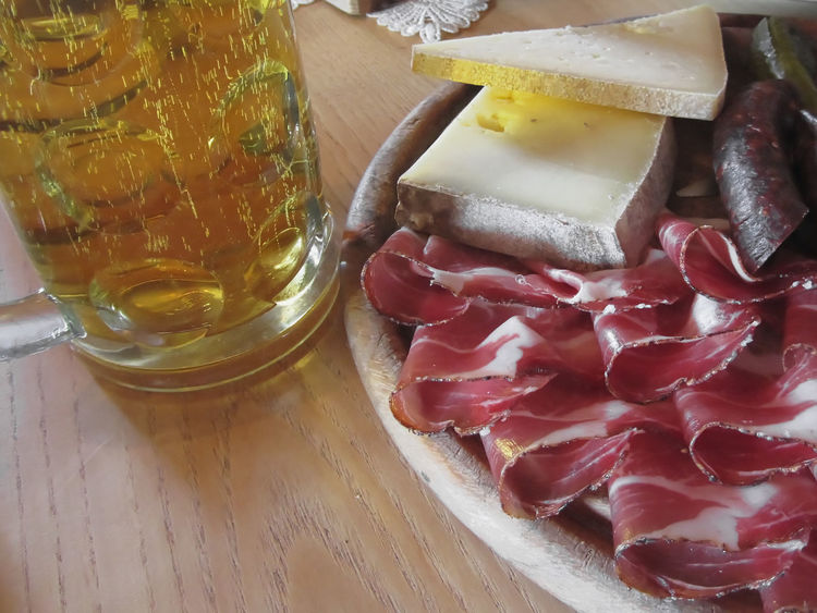 Typical South Tyrolean snack with speck, mountain cheese, smoked sausages and a cold mug of light beer Alto Adige Beer Cheese Cold Dinner Dish Eat Food Gourmet Italian Meal Mountain Mug Pork Rustic Sausage SLICE Smoked Sausage Snack Speciality Specialty Speck Table Tyrol Tyrolean