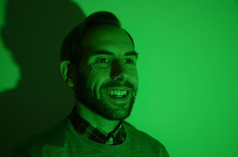 Happiness Bearded Man Smiling Cheerful Colored Background Green Background Green Color Headshot One Man Only Receding Hairline Smiling Studio Shot