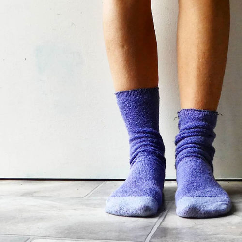 Low section of woman wearing socks