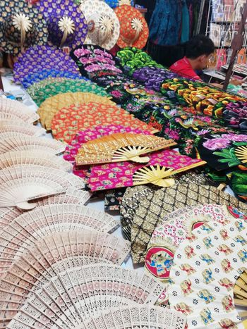 Fan Hand Fan Colourful Colour Colors Colorful Colours Colouful Bright Thailand #Chiang Mai Chiang Mai | Thailand No Filter Multi Colored Variation Close-up Handmade Display Fabric Foldable Stall Cloth Stories From The City EyeEmNewHere Adventures In The City #urbanana: The Urban Playground