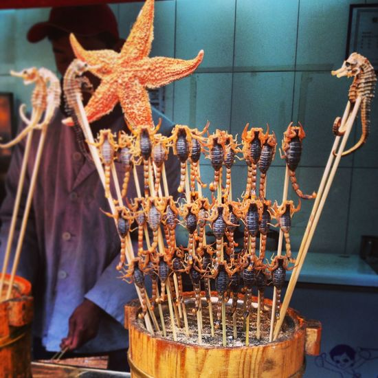 Fried Scorpions On Skewers At Market Stall