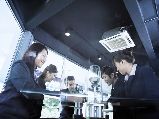group of business people at restaurant Business Celebration Collaboration Food And Drink Full Suit Happiness Lunch Refreshment Well-dressed Wine Glass Businessman Businesswomen Formalwear Group Of People Hotel Indoors  Low Angle View Lunch Meeting Occupation Real People Restaurant Success Teamwork Wine Working