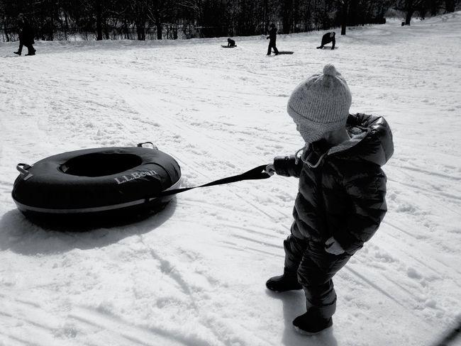 Sledding Boy Innertube Snow Winter boy pulling sled