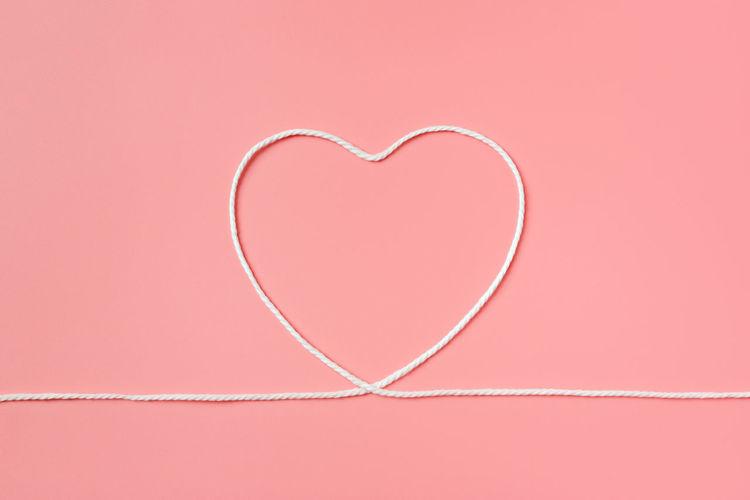 Close-up of heart shape on pink design