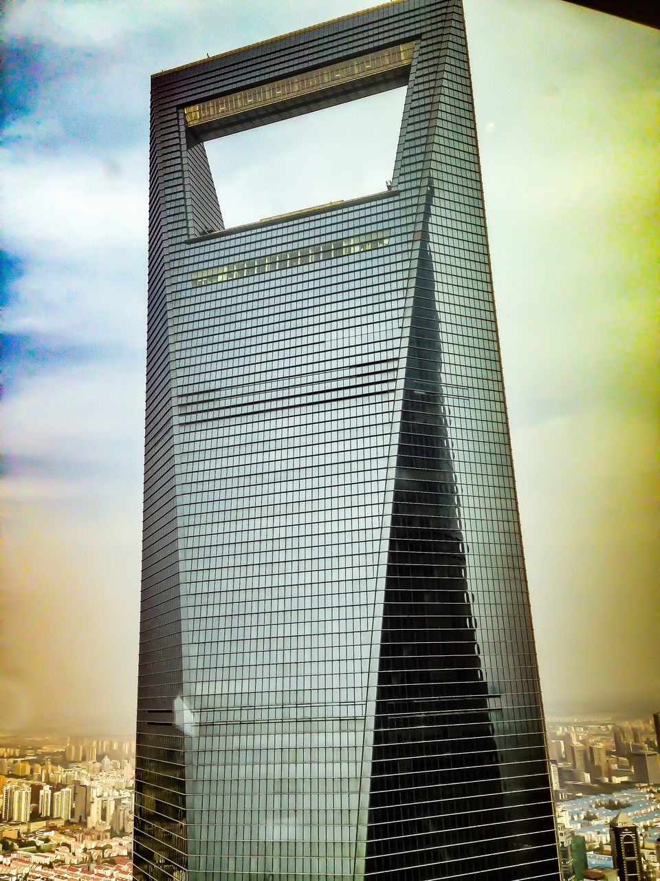 architecture, built structure, skyscraper, building exterior, modern, tall - high, tower, city, sky, low angle view, travel destinations, day, outdoors, cityscape, no people, pyramid
