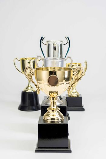 Variety of Trophy Cup on white background Trophy AWARD Winning Success Studio Shot Achievement Indoors  Competition Single Object Gold Colored Shiny Metal Still Life White Background No People Close-up Cut Out Pride Sport Gold Silver Colored