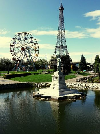 Reflection Tower Water Ferris Wheel Amusement Park Sky Travel Destinations Arts Culture And Entertainment Built Structure No People Architecture Day Outdoors