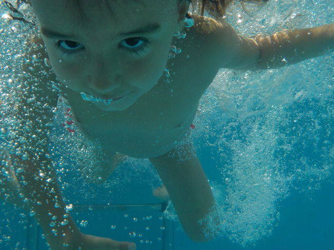 Childhood Day Innocence Looking At Camera Person Portrait Underwater Water Dramatic Angles The Culture Of The Holiday