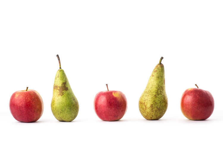 Isolated apples and pears in a line. Apple Apple - Fruit Close-up Food Food And Drink Freshness Fruit Granny Smith Apple Grocery Shopping Group Of Objects Healthy Eating Healthy Lifestyle Lunch Box Multi Colored No People One A Day One A Day Keep I Doctor Away Pear Pink Lady Red School Snack Studio Shot Tasty Food Variation White Background