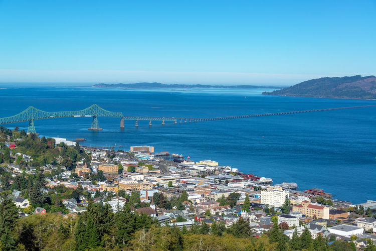 Cityscape view of Astoria, Oregon with the Astoria Megler Bridge and Columbia River Astoria Oregon Columbia River Tourism Travel Destinations Travel Sky Nature Outdoors Astoria-megler Bridge Astoria Megler Bridge Bridge City Landscape Water Sea Architecture Building Exterior Built Structure Blue Building No People High Angle View Plant Tree Day Scenics - Nature Residential District Horizon Clear Sky Horizon Over Water Cityscape TOWNSCAPE Bay River