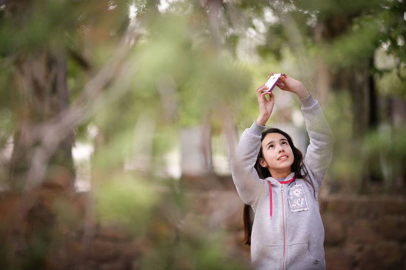 Argentina Casual Clothing Daughter Fun Happiness Happiness Little Girl Nature Person Plants Portrait Real People Selective Focus Take A Photo Tenderness Tree