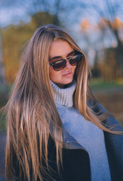 Autumn Adult Beautiful Woman Beauty Blond Hair Close-up Day Eyeglasses  Lifestyles Long Hair Nature One Person Outdoors People Portrait Real People Smiling Sunglasses Sweater Young Adult Young Women
