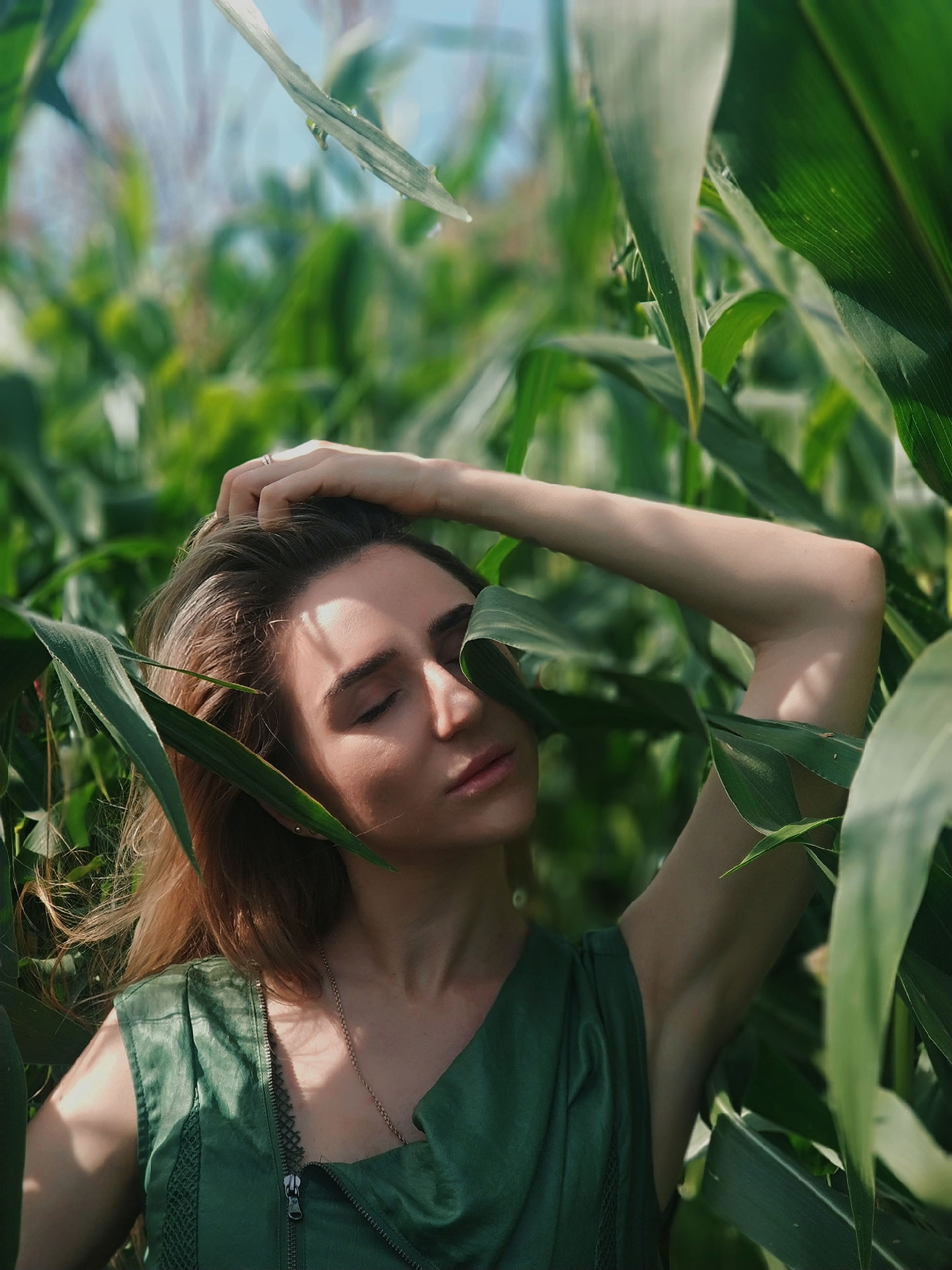plant, one person, young adult, real people, young women, portrait, growth, leaf, green color, leisure activity, plant part, lifestyles, nature, headshot, front view, day, women, agriculture, outdoors, hairstyle, beautiful woman