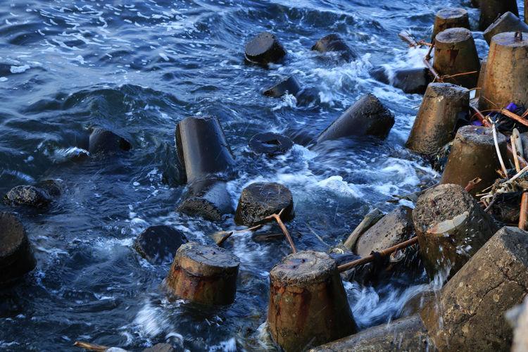 High angle view of water splashing on rocks
