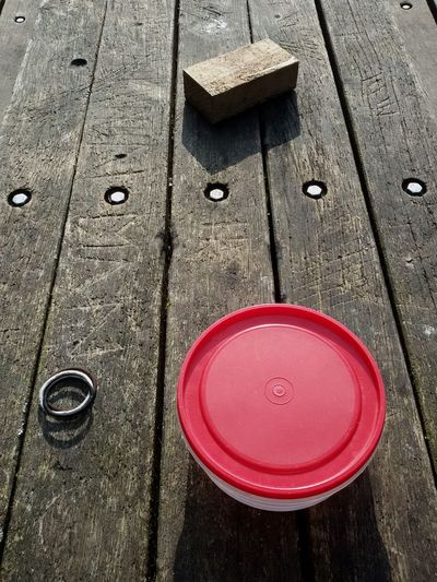 Plastic box on the table-project in the park Box Plastic Table Wood Park Texture Rusic Red Lid Planks Close Up Stil Objects Wood Brick Lines Hair Bands