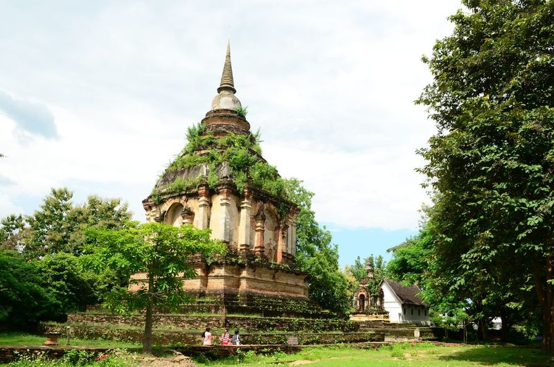 Tree Cloud - Sky Sky Architecture Outdoors Travel Destinations Day Religion Temples No People Grass Nature Temple Architecture ThaiTemple Pagoda Pagoda Building Pagoda Temple