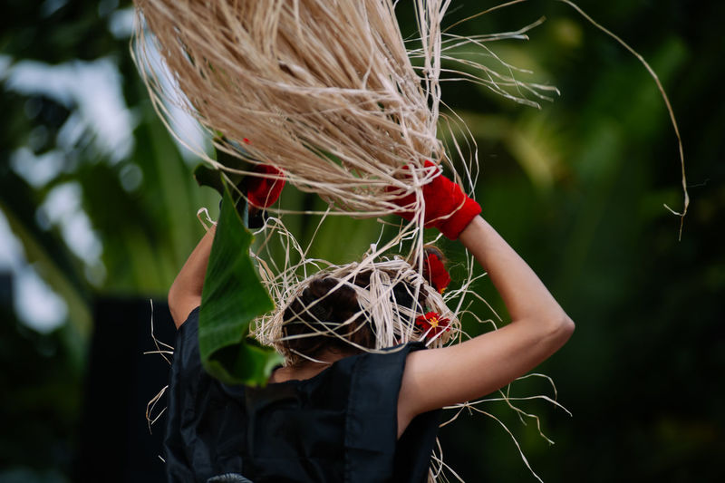 Blond Hair Close-up Day Field Focus On Foreground Front View Holding Human Body Part Land Leisure Activity Lifestyles Nature One Person Outdoors Plant Real People Selective Focus Waist Up Women