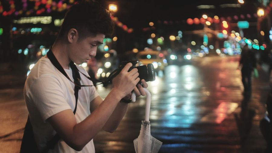 Shooting the Street Traffic Focus EyeEm Selects The Traveler - 2018 EyeEm Awards City Popular Music Concert Illuminated Wireless Technology Men Nightlife Young Men Holding Portable Information Device Street Light Lamp Post Lighting Equipment Electric Light Electric Bulb Filament Light Bulb