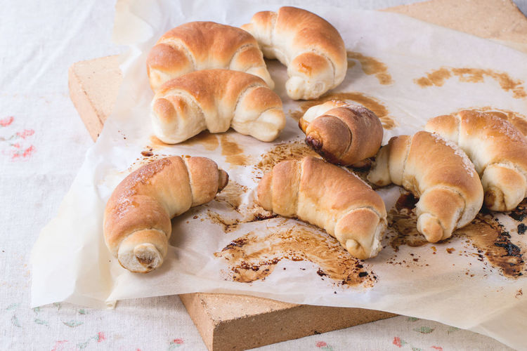 Fresh homemade baked crescent rolls on baking paper and oven stone over Baked Bakery Baking Paper Bread Bread Rolls Crescent Food Food And Drink French Food Fresh Baked Bread Healthy Eating Homemade Bread Homemade Food No People Ready-to-eat Rolls Stone Sugar Sweet Bun Table Tablecloth White