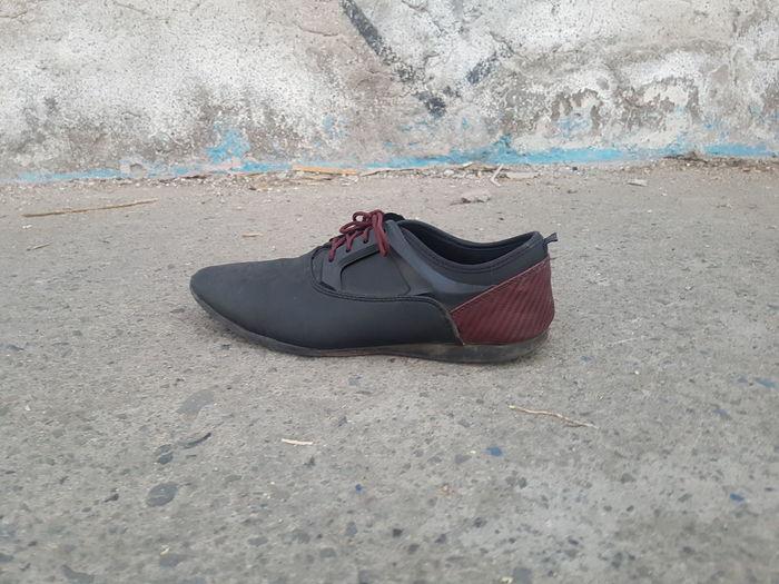 High angle view of shoe on sand on sidewalk