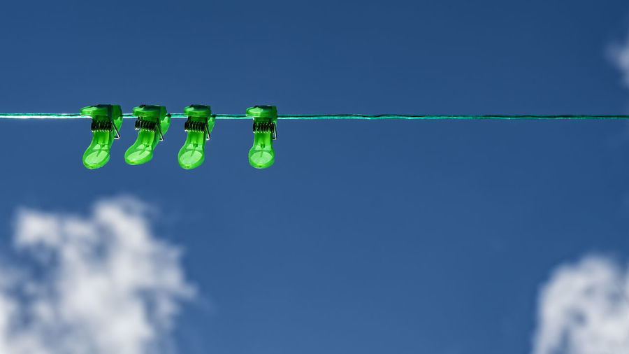 green clothes pegs Blue Blue Sky And Clouds Clear Sky Close-up Clothespins Day Green Clothes Pegs Green Color Green Color Green Line Hanging Low Angle View Nature No People Outdoors Sky