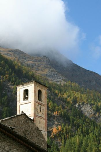 Mountain Architecture Nature Building Exterior Scenics Sky Built Structure Fog No People Outdoors Tree Beauty In Nature Day Foggy Weather Mountain Village Tower Bell Chianale Italian Alps Village Italian Village  Silence Moment Stone Building Atmospheric Mood Nature Harmony Foggy Mountains Old Church