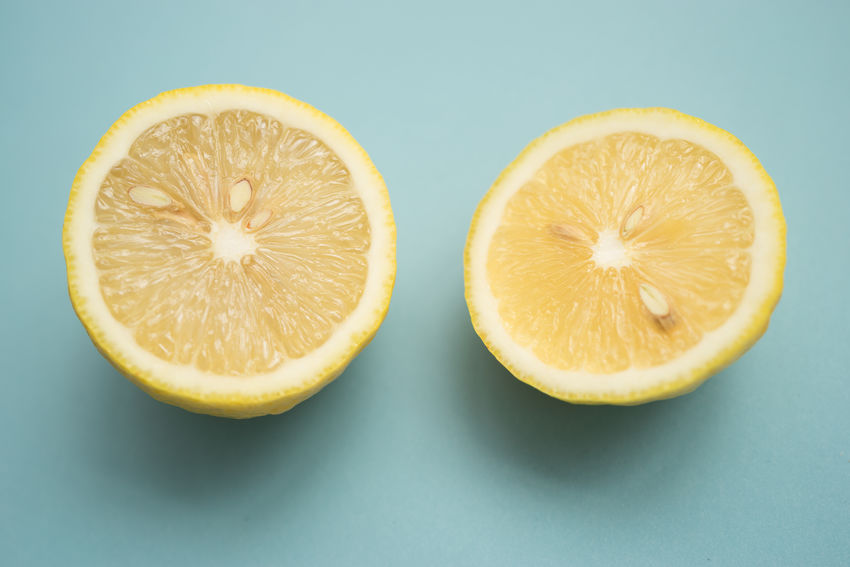 Freshness Blue Background Citrus Fruit Close-up Colored Background Cross Section Food Food And Drink Freshness Fruit Halved Healthy Eating Lemon SLICE Yellow
