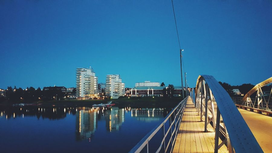 Panoramic View Of Bridge In City Against Clear Blue Sky