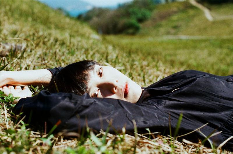 Cat lying on field
