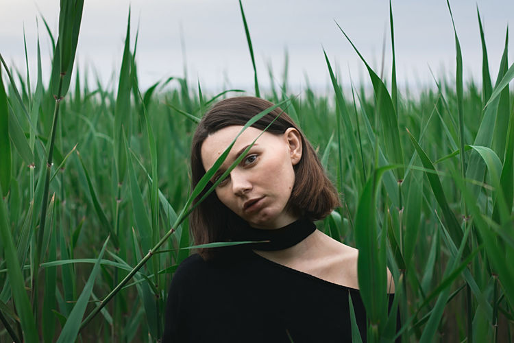 Young woman in the green reed bushes