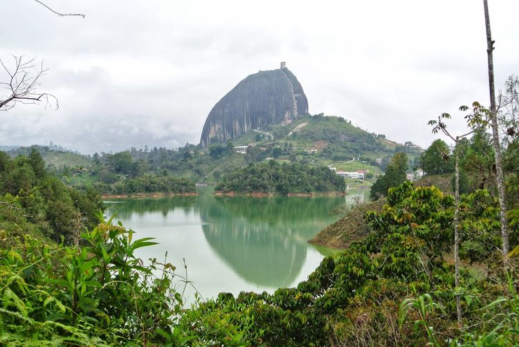 Guatape. 🇨🇴 Foggy Mist EyeEm Best Shots South America Latin America Travel Landscape_Collection La Piedra Del Penol Plant Landscape Nature Photography Nature Nature_collection Flooded Guatape Colombia Colombia ♥  Antioquia Medellín Reflection Reflections In The Water City Tree Water Reflection Mountain Lake Sky Architecture Green