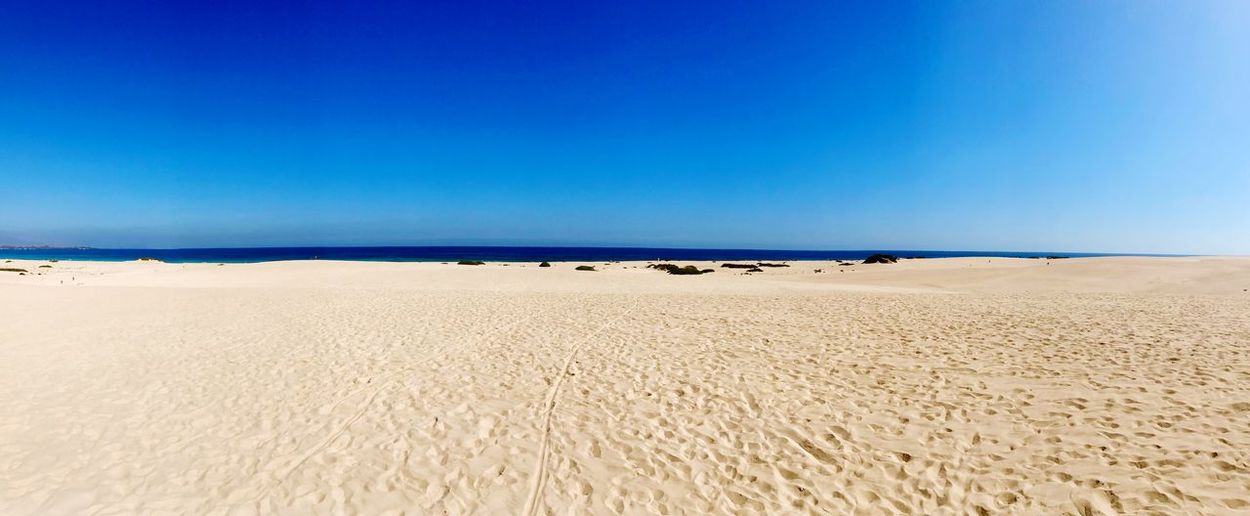 Mr. sky meets Mrs. lonely beach. Wide Air Space Sand Blue Pure EyeEm Selects Sky Water Blue Land Beauty In Nature Sea Beach Tranquil Scene Tranquility Scenics - Nature Sand Horizon Clear Sky Nature Copy Space Horizon Over Water No People Non-urban Scene Outdoors