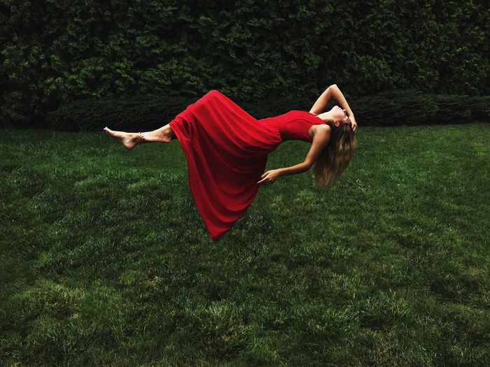 Red Dress Flying One Person Red Grass Plant Full Length Green Color Nature Leisure Activity Field Real People Women Relaxation Young Adult Lying Down Outdoors Day