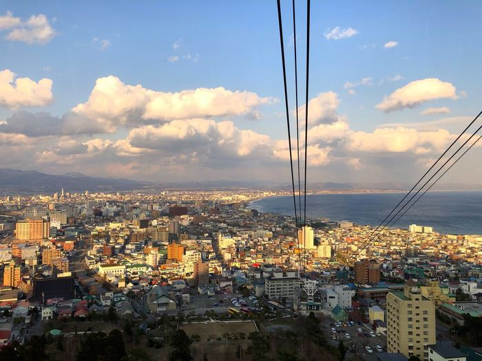 View from top of Mount hakodate Ropeway🚠 Hakodate,Hokkaido,Japan Sky Cloud - Sky Architecture City Built Structure Cityscape Building Exterior Day Sunset Sunlight Building Nature Crowd Residential District Crowded Water Outdoors