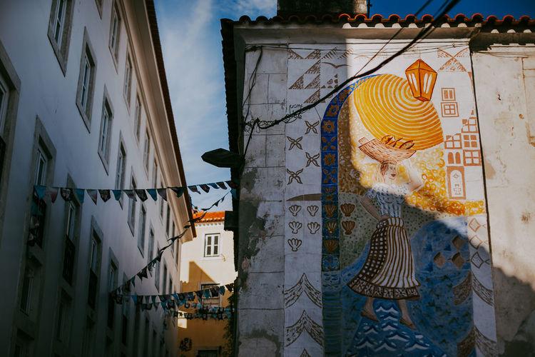 Built Structure Architecture Building Art And Craft Creativity Outdoors Window Sky Mural City Lisbon Portugal Sunlight Shadow Tourism Alfama Art Arts Culture And Entertainment Travel Destinations