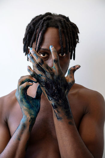 Artistic black man with painted hands