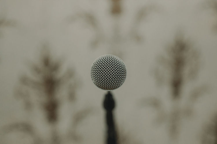 Close-up of microphone against cloudy sky