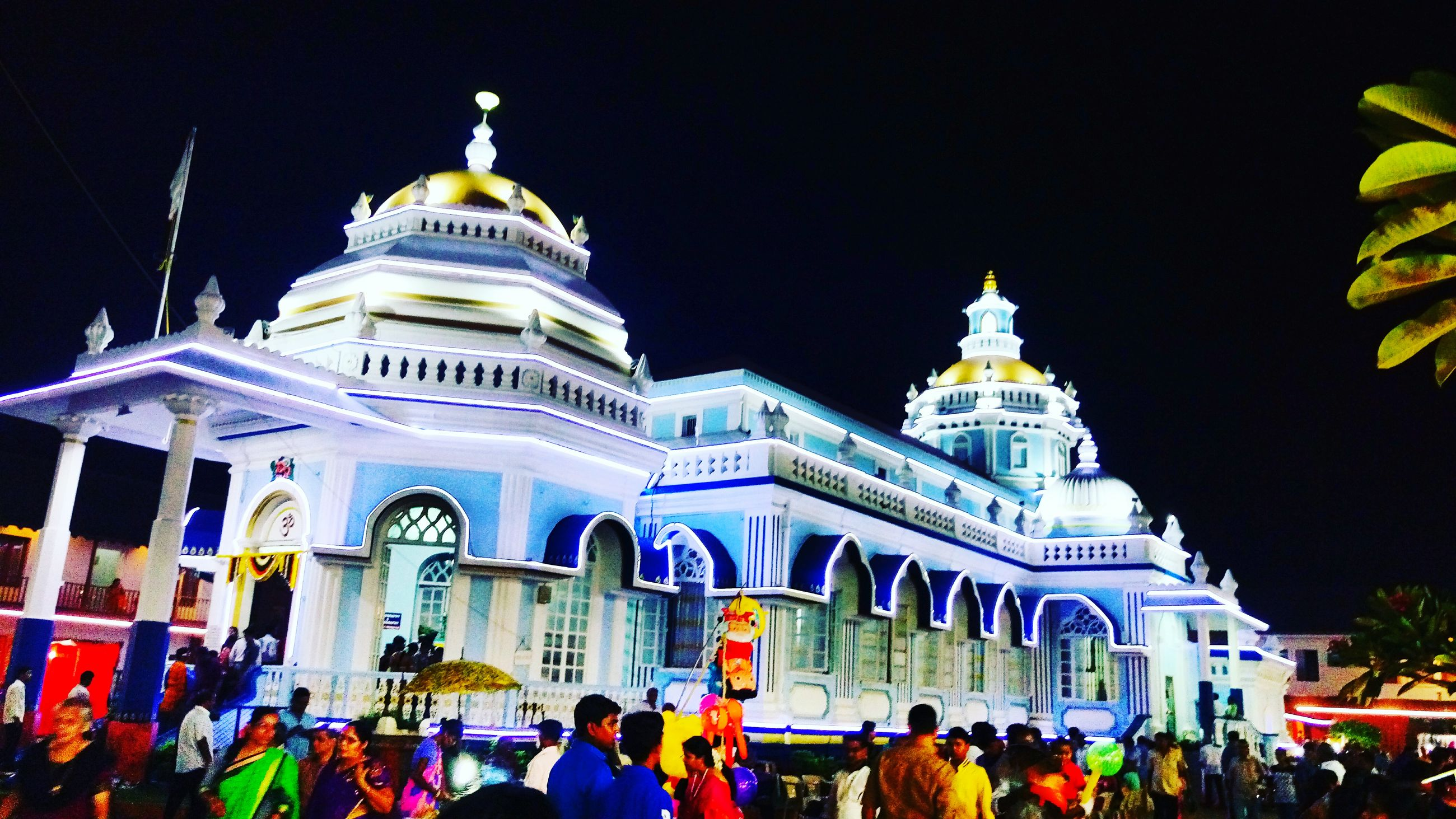 large group of people, architecture, built structure, building exterior, religion, place of worship, men, lifestyles, person, spirituality, famous place, crowd, travel destinations, tourism, illuminated, leisure activity, international landmark, travel, clear sky