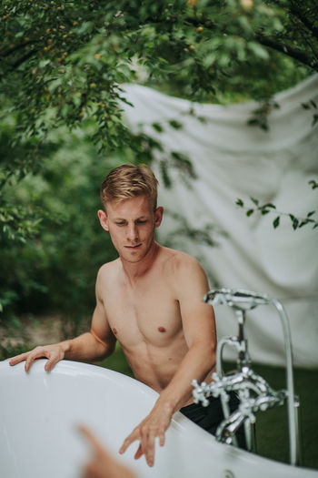 Portrait of shirtless man in water