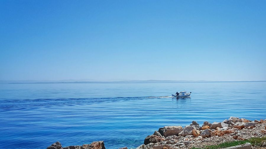 View of calm blue sea against clear sky