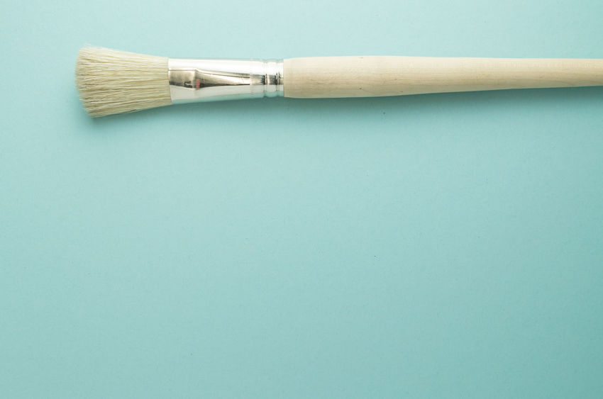 paintbrush Art And Craft Equipment Blue Blue Background Broom Brush Cleaning Close-up Colored Background Copy Space Equipment Hygiene Indoors  No People Paintbrush Simplicity Single Object Still Life Studio Shot Table Two Objects Wood - Material