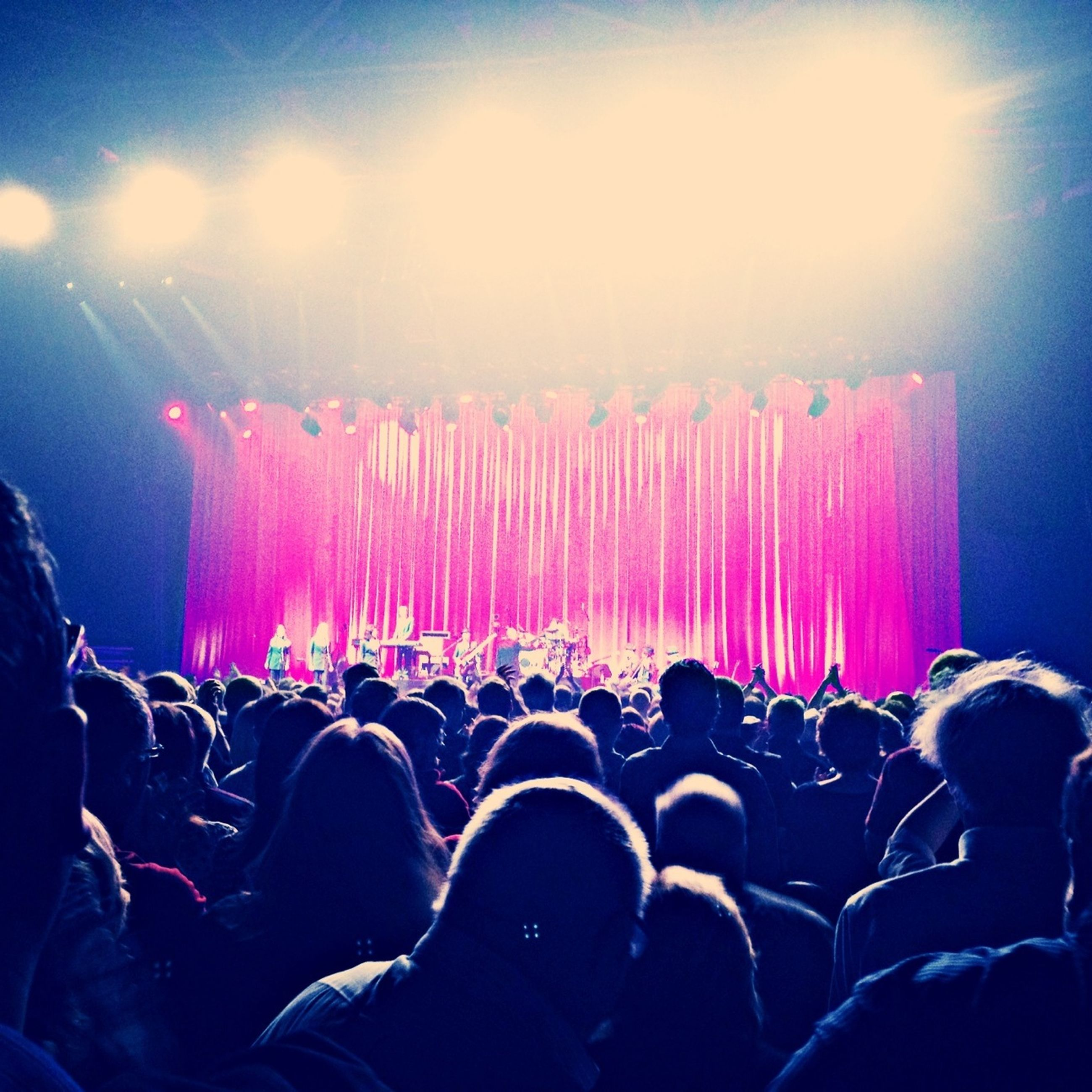 large group of people, crowd, lifestyles, enjoyment, leisure activity, person, men, arts culture and entertainment, fun, event, togetherness, celebration, performance, music, illuminated, excitement, music festival, sky