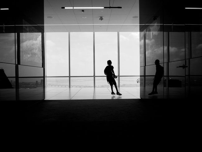 Adult Architecture Building Built Structure Day Flooring Full Length Glass - Material Group Of People Indoors  Lifestyles Men People Real People Reflection Silhouette Standing Transparent Walking Window