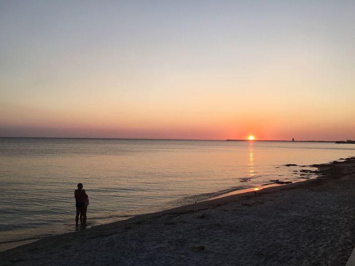 The Beach At Night Sunset Sea Tranquil Scene Tranquility Water Beach Scenics Silhouette Horizon Over Water Sun Vacations Solitude Shore Clear Sky Idyllic Standing Beauty In Nature Copy Space Remote Non-urban Scene