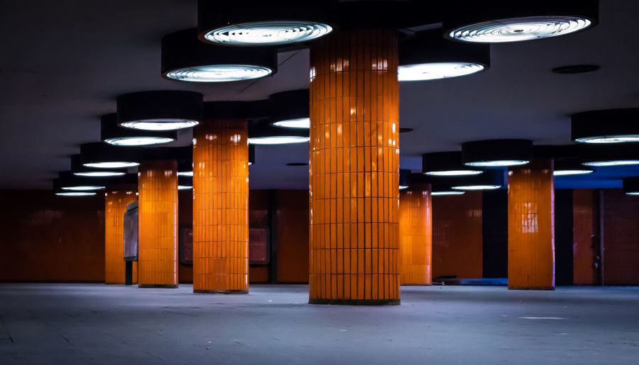 Business Charlottenburg  Futuristic Messedamm Underpass Architectural Column Architecture Building Built Structure Ceiling City Direction Electric Light Footpath Illuminated In A Row Indoors  Light Lighting Equipment Night No People Orange Color Pillars Repetition Road Transportation Travel Destinations Tunnel