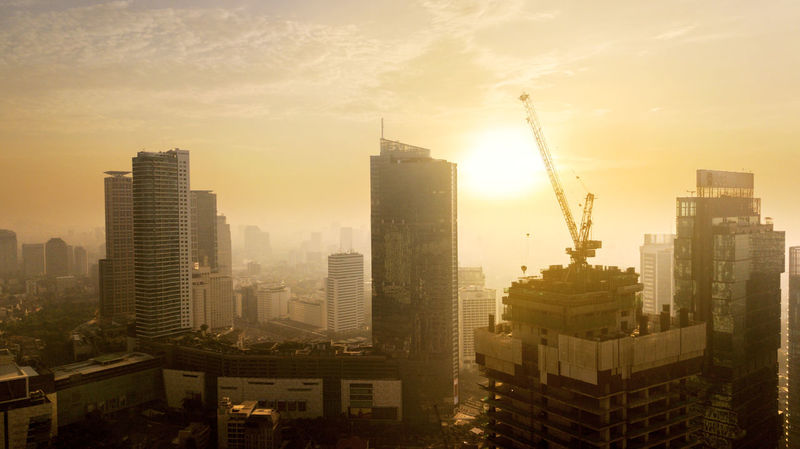 INDONESIA Jakarta Architecture Building Building Exterior Built Structure City Cityscape Construction Industry Development Financial District  Landscape Modern Nature No People Office Building Exterior Outdoors Sky Skyscraper Sun Sunlight Sunset Tall - High
