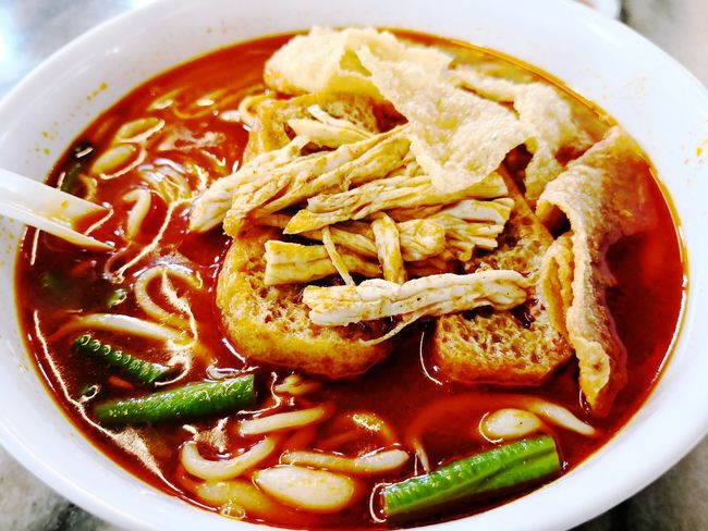 Curry Noodles with shredded chicken, tofu puffs, fried beancurd skin, long beans and bean sprouts. Cheras Currynoodles Tasty Yummy Delicious Beancurd Red Orange Spicy Food Food And Drink Food Bowl No People Healthy Eating Freshness Soup Fashion Stories Food Stories EyeEmNewHere