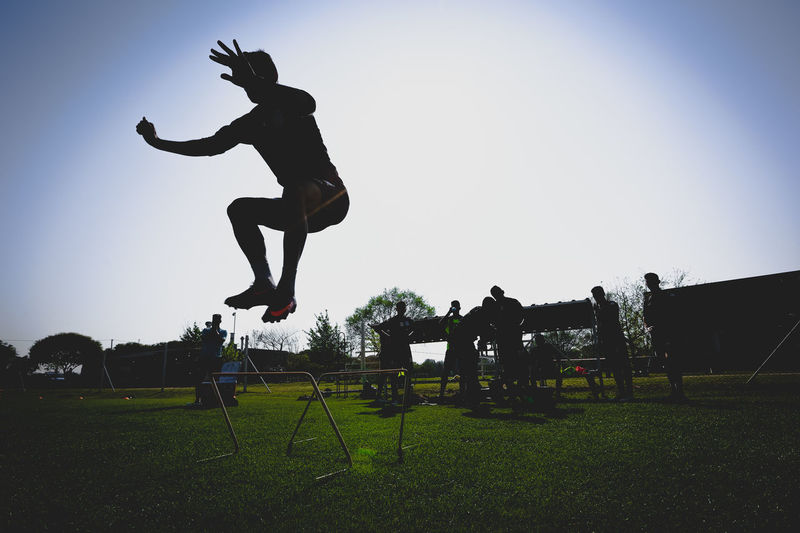 Belgrano EyeEm Best Shots EyeEmNewHere Villa Esquiú Clear Sky Competition Competitive Sport Day Energetic Eyeemsports Field Full Length Grass Jumping Lifestyles Men Mid-air Real People Silhouette Sky Soccer Sport Stunt Training