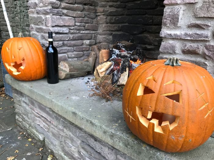 Hallowe'en pumpkins by the fire Wine Fireplace Fire Pumpkin Halloween Food And Drink Celebration Jack O' Lantern Food Orange Color Anthropomorphic Face Anthropomorphic Art And Craft Face Creativity Outdoors Holiday - Event